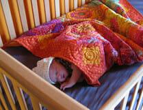 baby sleeping on natural latex crib mattress